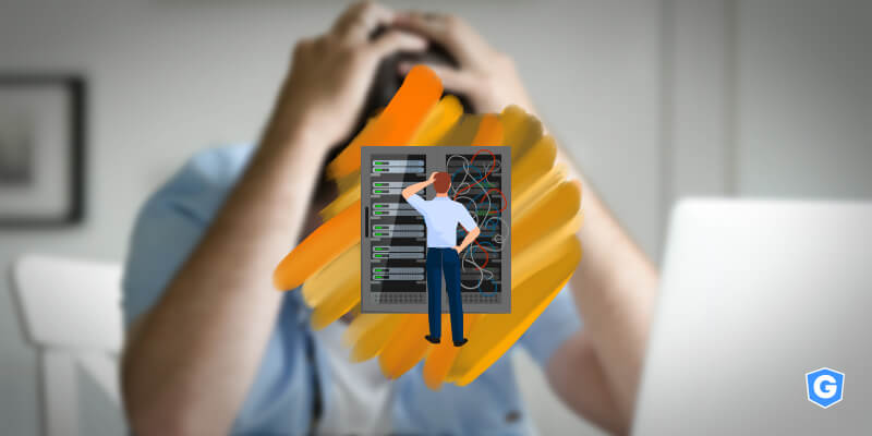 IT leader commiting cybersecurity mistakes and worried in front of a server and a computer