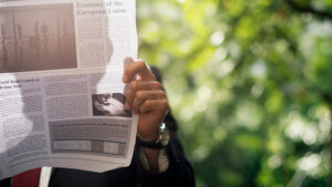 Man reading about a US newspapers' attack