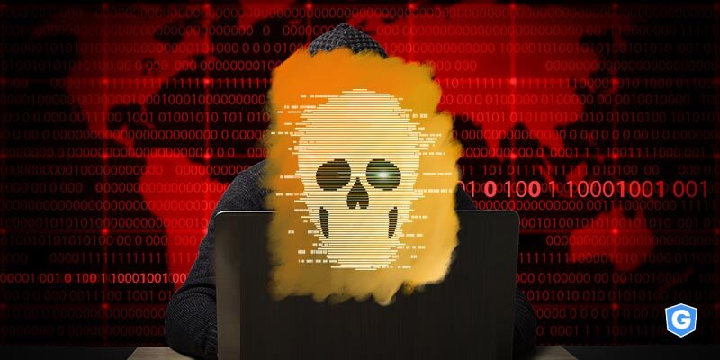 Cybercriminal hidden in a mask made by raas above a world map of codes